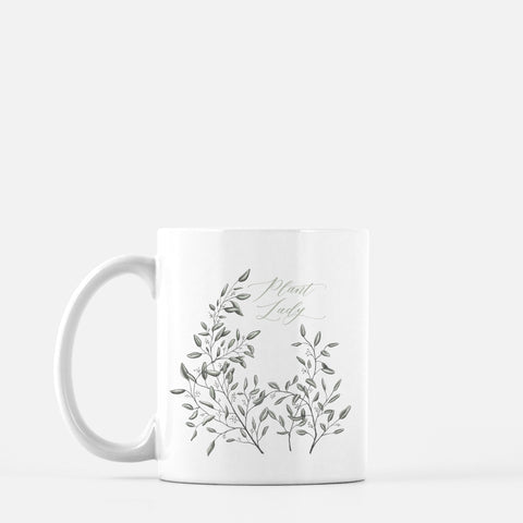 White ceramic mug with drawing of leafy greenery and words Plant Lady