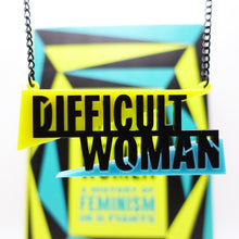 Load image into Gallery viewer, Difficult Woman necklace made to celebrate Helen Lewis's book Difficult Women close up hanging in front of book
