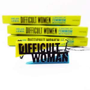 Difficult Woman necklace made to celebrate Helen Lewis's book Difficult Women shown in front of three paperbacks