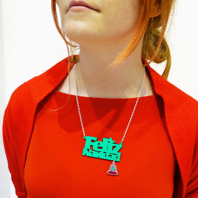 Model wears green Feliz Navidad festive necklace with glittery bell