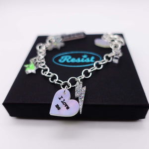 I love me charm bracelet shown on box, with star and lightning bolt charms