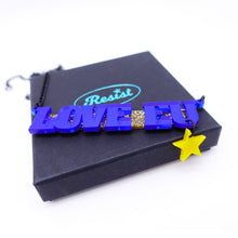 Load image into Gallery viewer, LOVE EU necklace on gift box with Wear and Resist logo
