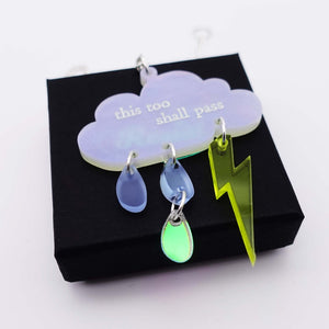 This too shall pass necklace on box.
