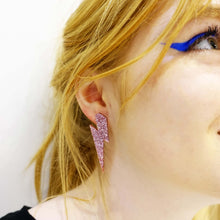 Load image into Gallery viewer, model wears large rose glitter lightning bolt studs
