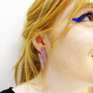 model wears large rose glitter lightning bolt studs