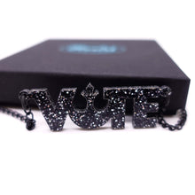 Load image into Gallery viewer, close up of black glitter vote necklace