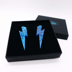blue glitter  large lightning bolt stud earrings shown in box
