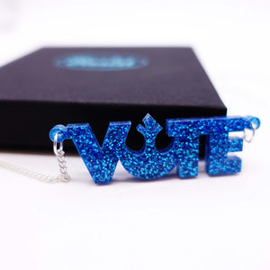 close up of blue glitter  vote necklace