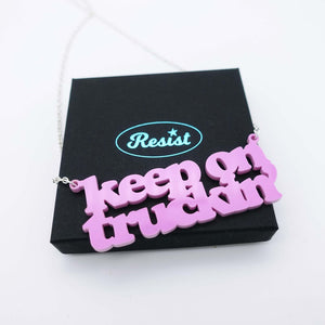 bubblegum pink Keep on Truckin' necklace shown on box