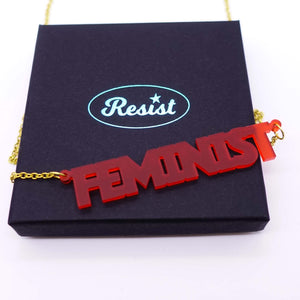 chilli frost all caps feminist necklace on box
