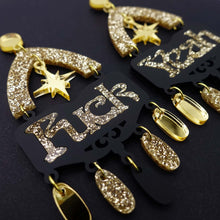 Load image into Gallery viewer, Fuck yeah earrings in black and gold glitter shown  in close up on black background