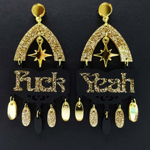 Load image into Gallery viewer, Fuck yeah earrings in black and gold glitter shown hanging on black background