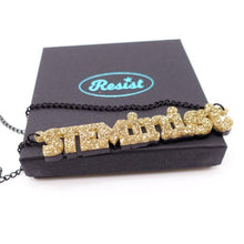 Load image into Gallery viewer, gold glitter STEMinist necklace on box