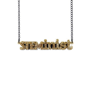 gold glitter STEMinist necklace hanging shot