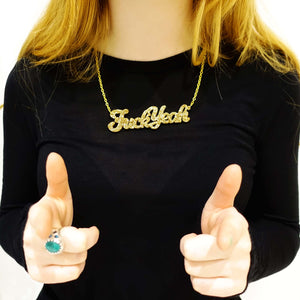 Model wears gold glitter Fuck Yeah necklace