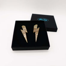 Load image into Gallery viewer, gold glitter  large lightning bolt stud earrings shown in box