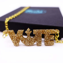 Load image into Gallery viewer, close up of gold glitter Rebel Alliance vote necklace