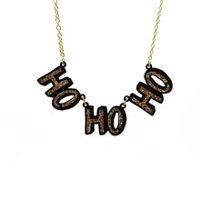 Load image into Gallery viewer, Gold HO HO HO Christmas necklace hanging