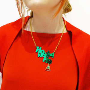 Model wears Ho Fucking Ho necklace with gold bell. Have a sweary Christmas!