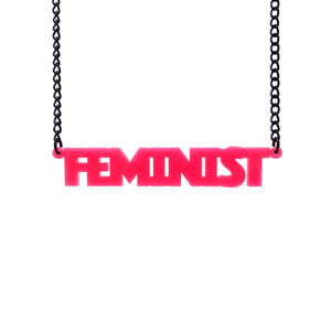 hot pink all caps feminist necklace hanging