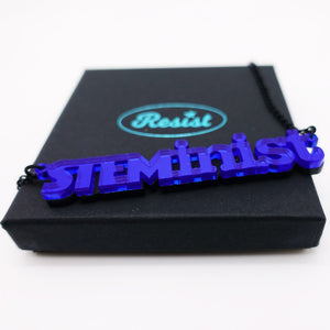 indigo mirror STEMinist necklace on box