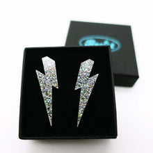 Load image into Gallery viewer, holo silver glitter medium lightning bolt stud earrings shown in box