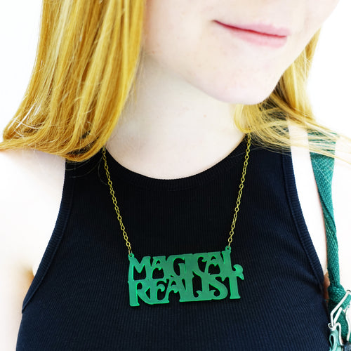 model wears leaf frost magical realist necklace for writers and book lovers