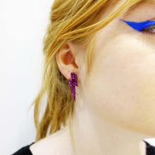 Load image into Gallery viewer, model wears medium purple glitter lightning bolt studs