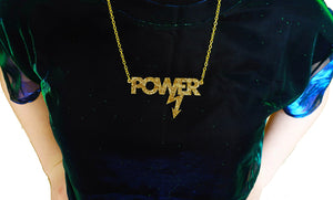 model wears gold glitter Mary Beard power necklace