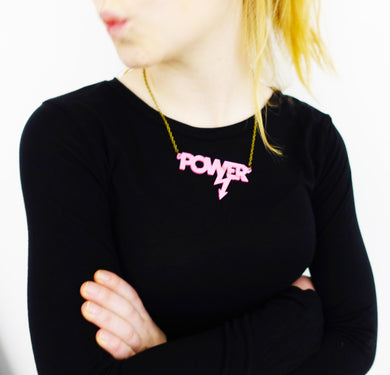 model wears pink mirror Mary Beard power necklace
