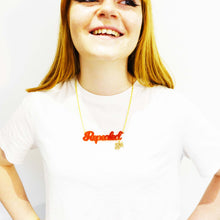 Load image into Gallery viewer, Model wears repealed the 8th chilli frost red necklace with gold 8th