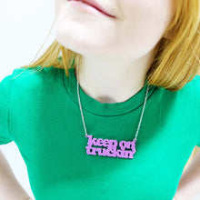 Load image into Gallery viewer, model wears bubblegum pink Keep on Truckin' necklace