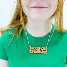 Load image into Gallery viewer, model wears orange sherbet keep on truckin necklace