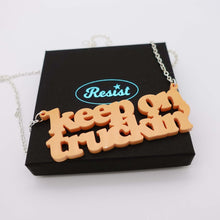 Load image into Gallery viewer, orange sherbet Keep on Truckin' necklace shown on box