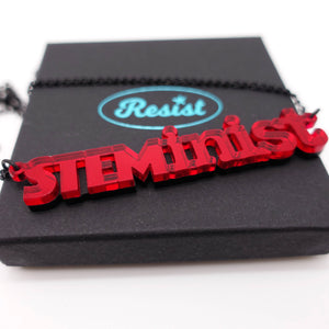red mirror STEMinist necklace on box