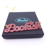 rose glitter  bookish necklace on box
