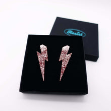 Load image into Gallery viewer,  large rose glitter lightning bolt stud earrings shown in box