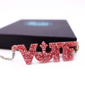 close up of rose glitter  vote necklace