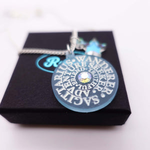 Close up of Sagittarius Astrology Zodiac Starsign necklace on box
