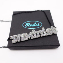Load image into Gallery viewer, holographic silver glitter STEMinist necklace on box