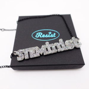 holographic silver glitter STEMinist necklace on box