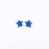 blue glitter small star earrings