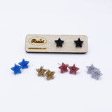 group shot showing all small star earrings