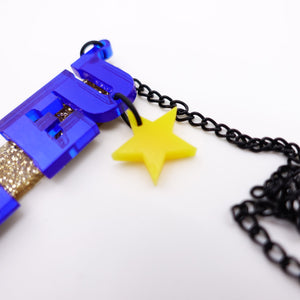 close up of necklace showing yellow star