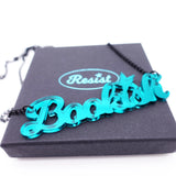 teal mirror  bookish necklace on box