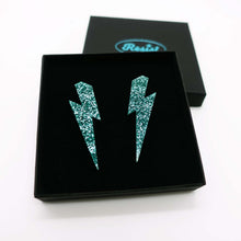 Load image into Gallery viewer, teal glitter  large lightning bolt stud earrings shown in box