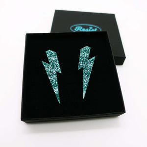 teal glitter  large lightning bolt stud earrings shown in box