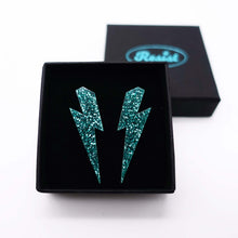 Load image into Gallery viewer, teal glitter medium lightning bolt stud earrings shown in box