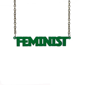 transparent emerald all caps feminist necklace hanging