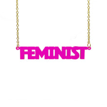 Load image into Gallery viewer, transparent hot pink all caps feminist necklace hanging